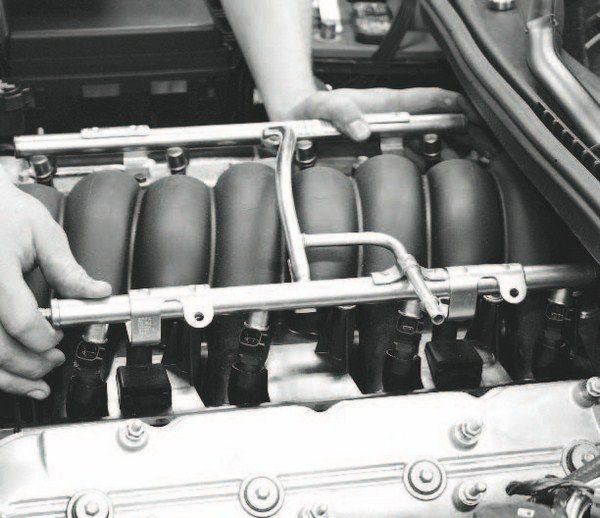 After routing the intercooler plumbing, attention turns to the fuel system. The kit's highercapacity, 60-pound/hour injectors were swapped onto the stock fuel rail. Then, the fuel rail was simply pushed back into place on the intake manifold.