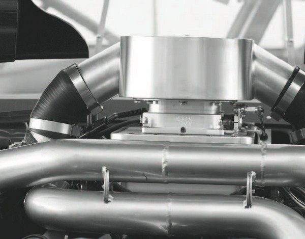 Speed density air metering is the way to go with racing engines, because, generally speaking, it can be programmed to handle more power than a mass air-metered engine. It is also necessary on setups like this twin-turbo engine, where air enters the intake plenum in two places and uses multiple throttle bodies.