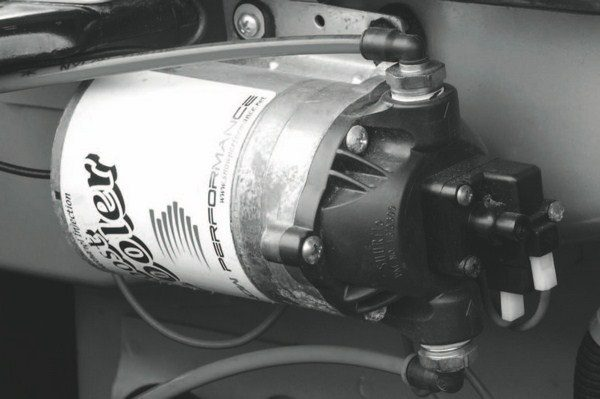 Also required for a methanol injection system is a pump to deliver the solution to the intake system. Unfortunately, the pump for the windshield-washer system that pairs with the reservoir isn't strong enough to generate the pressure necessary to provide a finely atomized spray of the alcohol solution in the intake tract. This example is from methanol injection specialist Snow Performance.
