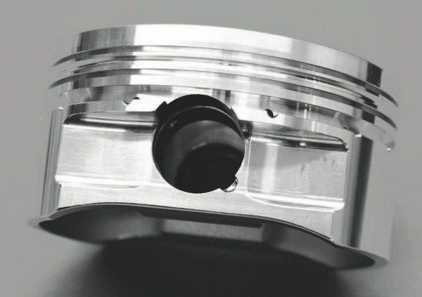 The side profile of a piston shows the crown height (defined as the space between the top ring land and the top of the piston). The minimum crown height for a forced-induction LS engine should be .200 inch; .300 inch is optimal. Production LS pistons don't have such a thick crown, which (in addition to their cast construction) is why they're not great in high-boost supercharged or turbocharged applications.