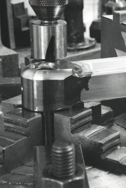 Machining material off aluminum rods is another method of making them fit the tight confines of a bigstroke combination, but doing so can adversely affect strength and lower the lifespan of an already-stretchprone component that doesn't have the tensile strength of steel.