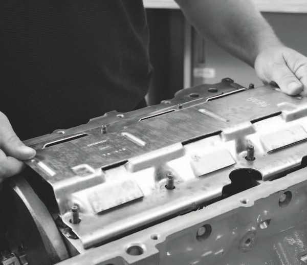 All LS engines employ a windage tray. During assembly, it should be checked for interference with the crankshaft and rods. The process includes bolting down the tray after the rotating assembly has been installed and all the fasteners torqued to specification.