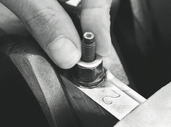 If a windage-tray interference issue is discovered, stacking washers on the main cap studs that also secure the windage tray is the easiest method of curing the problem. Start with a single washer on each stud and re-check the clearance, adding washers until a satisfactory clearance is achieved.