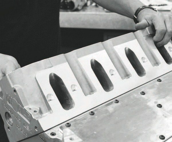 An aftermarket alternative to GM heads is World Products' Warhawk cylinder heads, offered in LS1X and LS7X styles. Each has a six-bolt design that corresponds with World's Warhawk cylinder block, but can be bolted to a GM block using the standard four-bolt pattern. The LS1X features cathedral ports, a 15-degree valve angle, 235-cc intake runners, 2.080/1.600-inch valves, and is available with 64- or 72-cc combustion chambers. The LS7X head has rectangular ports, a 12-degree valve angle, 285-cc runners, 2.250/1.625-inch valves, and 64- or 72-cc chambers. On either head, selecting the smaller chamber volume will promote a higher compression ratio, so it must be matched with an appropriate dished piston design to keep the compression around 9.0:1 and 9.5:1 (or lower).