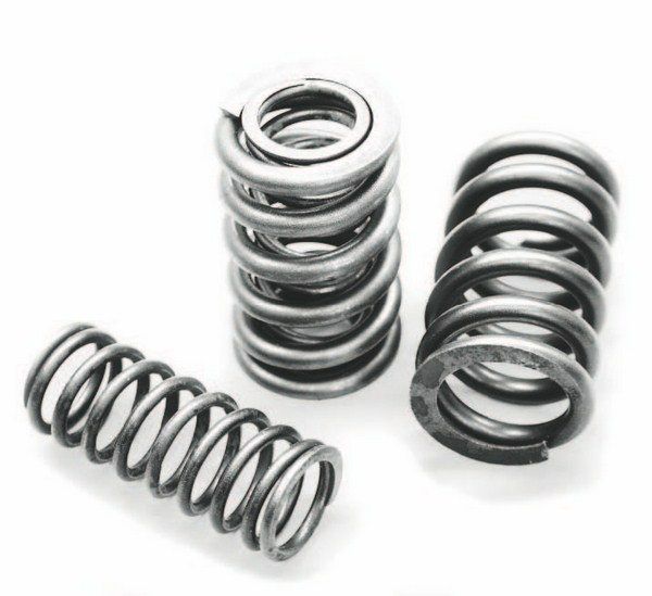 Higher-rate valvesprings are a must on a purpose-built forced-induction LS engine, especially if the combination includes a camshaft that exceeds about .510-inch lift. Shown here are the components of Comp Cams' 1.30-inch dual-coil valvespring, which withstands up to .600-inch lift without binding. The dual-coil design is heavier than the production-style beehive design, but offers exceptional strength and resistance to boost pressure. Using titanium retainers with the springs helps offset their additional weight over the stock springs.
