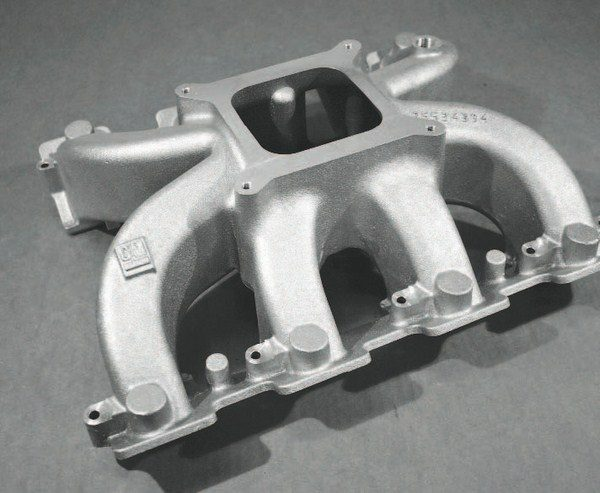 The use of a carbureted-style aluminum intake manifold comes with racing applications that will see very high boost pressure and require custom plumbing to route largediameter tubing through the engine compartment.