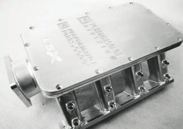 This impressive-looking tunnel-ramstyle intake has a fatal flaw for highboost forced induction: As air rushes through the front of the manifold under pressure, it packs into the rear intake runners, leaving the front runners relatively starved. A better solution would be to introduce the air at the top of the manifold, where the airflow would be better spread among the runners.