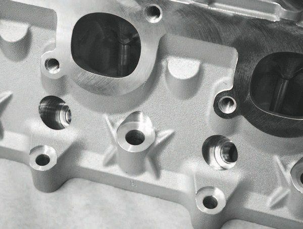 The cylinder heads are prototype LSX racing heads, but they're based on the same six-bolts-per-cylinder design as GM Performance Parts' recently introduced LSX street head. The CNC-ported combustion chambers of the heads displace only 45.6 cc— a tight displacement that drove the deep-dish design of the pistons.