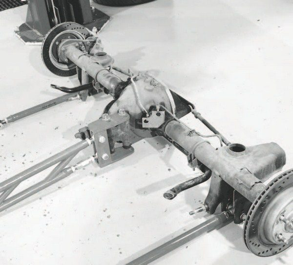 Here's the stock, 7.5-inch 10-bolt axle out of our fourth-generation Camaro project car. While it served well for moderate increases in power and torque, it wouldn't stand up to the forces put to it by a new supercharger combination. The aftermarket suspension parts attached to it will be transferred to the new axle.