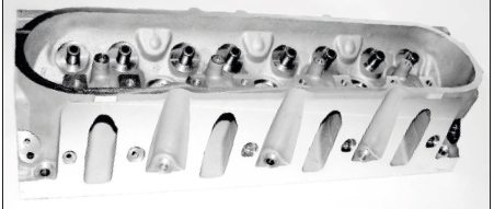 The LS1/LS6/LS2-style cathedral-port cylinder head (seen here) doesn't offer the maximum flow characteristics of later heads that are based on the rectangular port design of the LS7 engine, but they are adept at generating excellent torque. With minor adaptations, later heads can be swapped on LS1/LS6 engines to maximize the airflow offered by the power adder. Also, 6.0-liter engines can use 6.2-liter L92/LS3-style heads to great effect, but again, they must be matched with the correct intake manifold. A 6.0-liter intake, for example, doesn't fit LS3 heads; and the LS7 intake fits only LS7 heads.