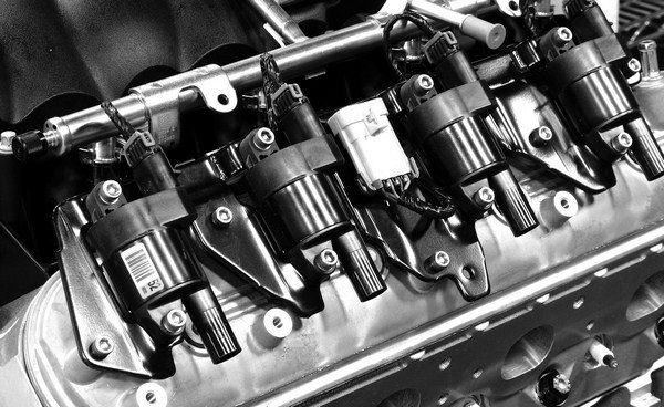 They don't do much for aesthetic value, but Gen III/IV smallblocks have a separate coil pack for each spark plug mounted on the valve covers. This provides a much more powerful spark to ignite the air/fuel mixture, and it eliminates the need for a distributor, as the coils receive instructions directly from the engine management computer.