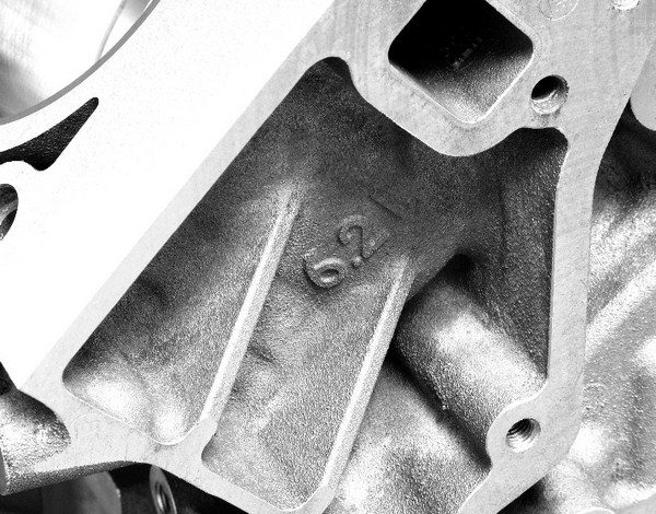 """Factory aluminum and iron blocks are easily identified by marks, cast into the front or back of the block, that denote their displacement. Shown here is a 6.2L block. Small-bore iron blocks are labeled """"4.8L/5.3L,"""" because they're used in 4800 and 5300 Vortec motors."""