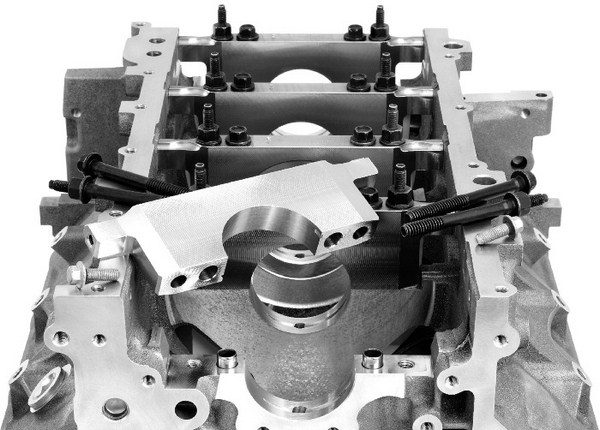 Although it's very difficult to break the stock main caps, they start moving around at the 1,000-hp mark. To combat this, LS7 and LS9 blocks incorporate a sleeve positioned inside the two inner main bolt holes.