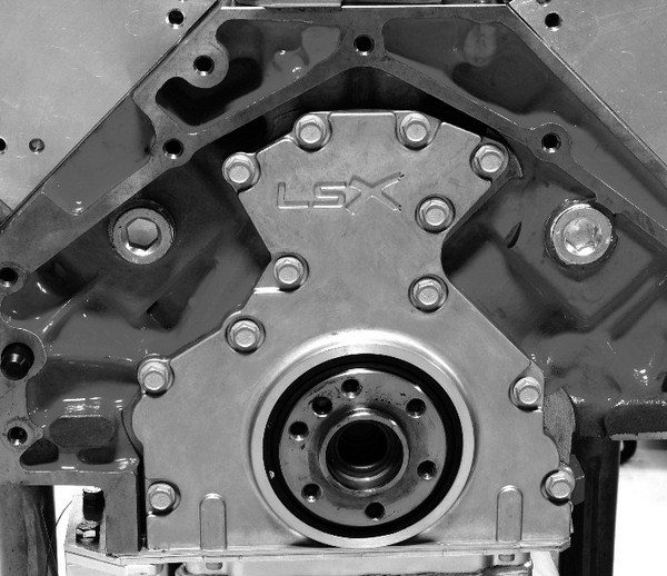LS blocks feature a traditional six-bolt bellhousing bolt pattern, but with a slight twist. On production LS blocks, the bolt hole in the upper right-hand corner (arrow) is absent, and it is replaced with another hole at the very top of the pattern that's not present in Gen I blocks. Consequently, transmissions designed for either engine bolt up to both LS motors and Mouse motors, but with one of the bolts missing. Aftermarket blocks, like the GMPP LSX, typically have all seven holes drilled and tapped.