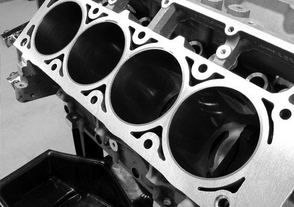 Opening up the bore not only increases displacement, it also creates extra space for larger valves and improves cylinder head flow by moving the cylinder wall farther away from the valves. In order to fit cylinder heads having large 2.165-inch intake valves, as in the L92 castings, GM had to increase the bore to 4.065 inches.