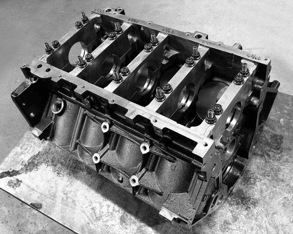 When it comes to sheer strength, the Vortec 6.0L iron block is the best value among all stock and aftermarket blocks, period. Because the Gen III block was originally designed as an aluminum casting, it features extensive reinforcement ribbing to reduce deflection. Cast that same design in iron, and the result is a block that weighs 70 pounds more but can support more than 1,000 hp. At high power levels, iron blocks typically offer superior ring seal than aluminum blocks. Best of all, a secondhand Vortec 6.0L block can be had for less than $500. (© GM Corp.)