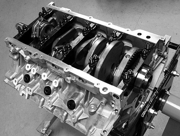 One of the biggest advantages of aftermarket blocks over production blocks is their spread oil pan rails. This enables them to swallow up long strokes without a builder's need to grind them for clearance. Even with a 4.500-inch stroke, the connecting rods clear this RHS block with room to spare.
