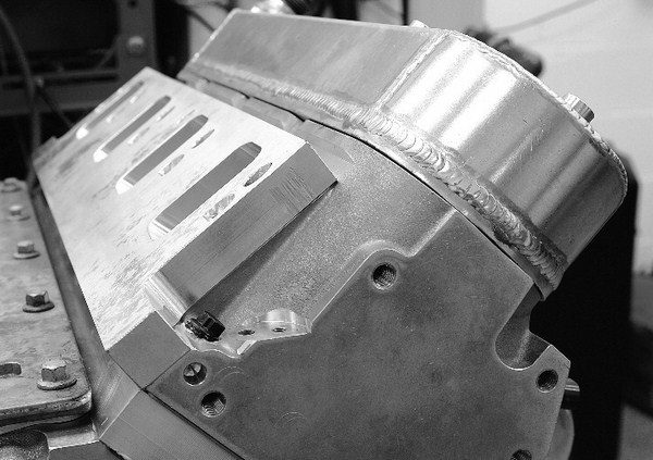 Because the cylinder banks are situated at a 90-degree angle, moving the heads upward also moves them farther apart from each other. To compensate for this, ERL provides billet adapter plates that fill the gap that would otherwise exist between the cylinder heads and the intake manifold.