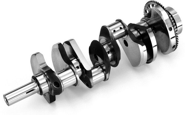 The 4.000-inch LS7 crankshaft is the longest crank ever used in any Chevy small-block of any generation. It's forged from 4140 steel and features a crank snout that's nearly 1 inch longer than that of a standard Gen III/IV crank; it's made longer to accommodate the dry sump oil pump. With the introduction of the Gen IV LS2 in 2005, GM began replacing 24-tooth reluctor wheels with 58-tooth units. (© GM Corp.)