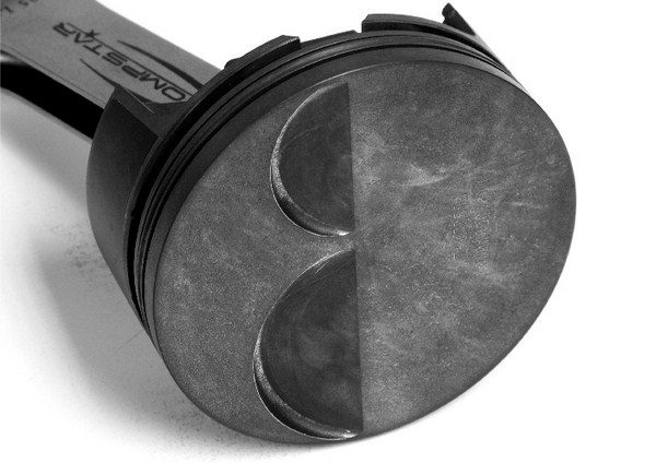 The crown of a flat-top piston isn't always flat. With long-duration camshafts and big valves, it's often necessary for piston manufacturers to cut valve reliefs into the top of the piston.