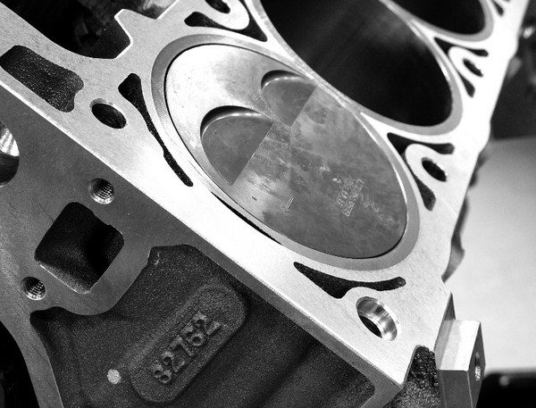 With the cylinder heads bolted in place, quench area is defined as the space between the top of the piston and the bottom of the area surrounding the combustion chamber. Reducing this gap squeezes the air/fuel mixture very tightly on the compression stroke, causing it to shoot into the chamber and help homogenize the fuel droplets. This improves an engine's detonation resistance and power. The tightest quench clearance recommended by race engine builders is .039 inch.