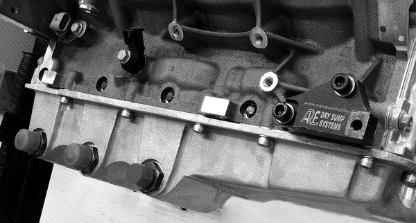 Aftermarket companies, such as ARE Dry Sump Systems, manufacture dry sump oiling systems for road racing applications. Aftermarket systems employ an external oil pump that is driven off the accessory drive belt.