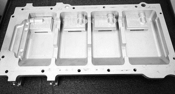 Dry sumps aren't just for road-race vehicles. High-RPM drag racing motors also benefit from them, because they virtually eliminate windage. Katech's four-stage billet pan has four separate oil pickup points.