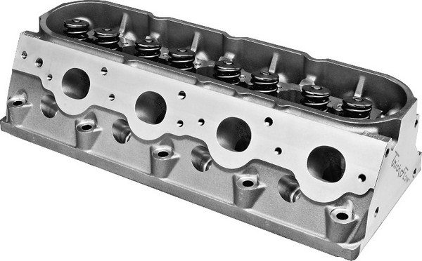 Although the growing popularity of fiveaxis CNC machines has made CNCported cylinder heads much more affordable, head casting technology has improved dramatically to enable the production of competitive heads. Trick Flow offers 225-cc heads that flow 305 cfm, and they are much cheaper than the typical CNC head.