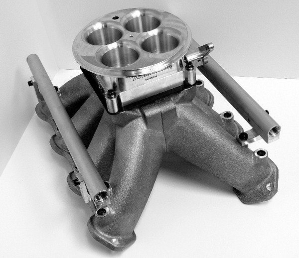 Raising the carburetor allows for much more flexibility when designing a singleplane intake manifold. The runners can be made very large for high-RPM breathing, but they can also be made very long to promote low-RPM torque production. Tapering down the cross-sectional area of the runner also helps enhance this dualpurpose effect.