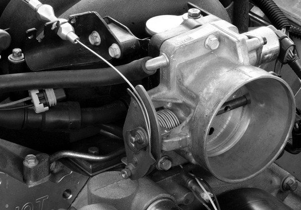 Factory throttle bodies are either actuated by a throttle cable or an electric motor. A drive-by-wire throttle body can be used in an engine swap application, but it must interface with a matching computer and a stock gas pedal.