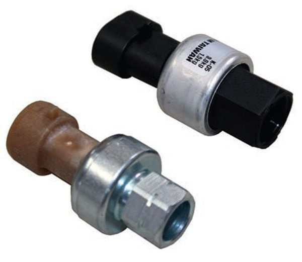 The A/C pressure sensor (left) reports a 0 to 5V signal to pin 14 of the red PCM connector that represents the pressure of the A/C system. The A/C low-pressure switch (right) indicates whether the A/C pressure is low by applying a ground to pin 55 of the red PCM connector.