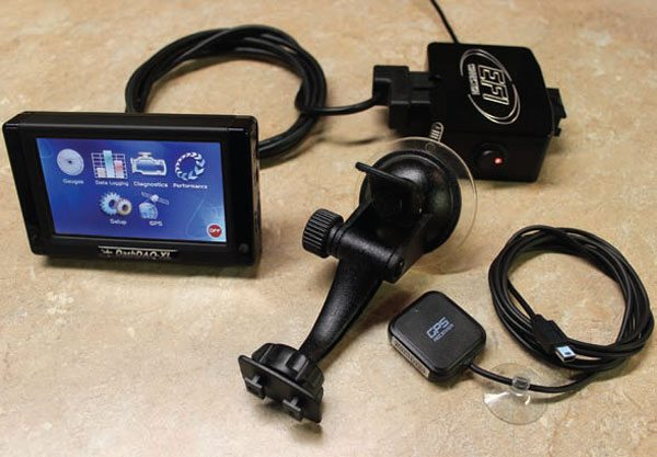 OBD-II standardization has been an incentive for Manufacturers to offer OBDII scan tools. A brief Internet search reveals hundreds of available OBD-II scan tools. This is Drew Technologies' DashDAQ-XL, a high-end, feature-packed scan tool. This model has windshield mount (standard), GPS receiver (optional), and bench-top OBD-II power assembly (an EFI Connection product used here as a power source).