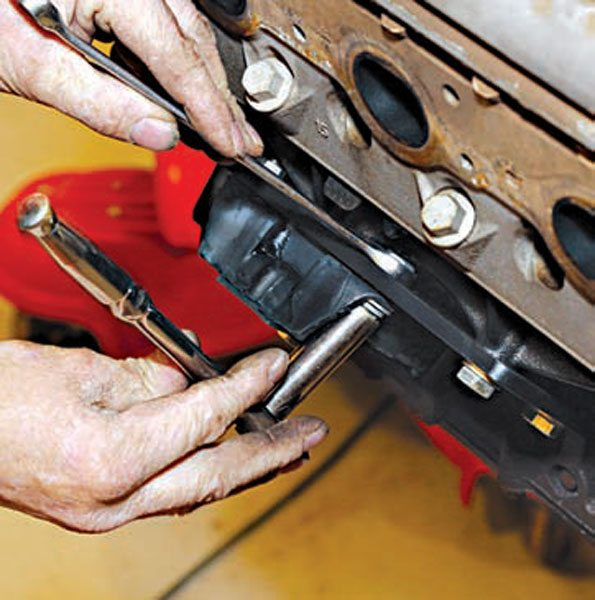 Once the locking nuts have been installed on the back side of the plate, the bolt is tightened in the threaded plate and then the lock nut is tightened.