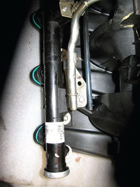 The stock rail tube fitting does not have any threads. You can use the stock-type line, but most opt for AN adapters. (Photo Courtesy Street & Performance)