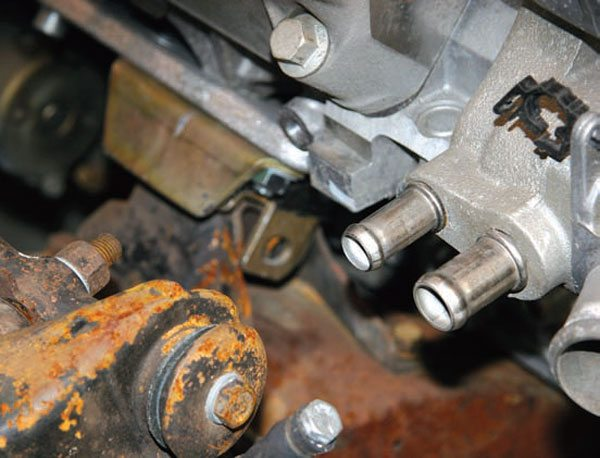 1. The stock heater line fitting might not clear the suspension or frame in some installations. This can be rectified. (Photo Courtesy Street & Performance)
