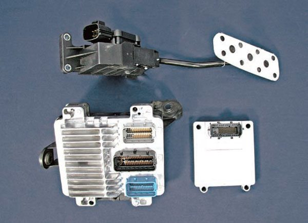Each drive-by-wire engine requires its own specific pedal, throttle body, and possibly TAC module. This is an LS2 kit for a GTO. The small box on the lower right is the transmission control module (TCM). (Photo Courtesy Street & Performance)