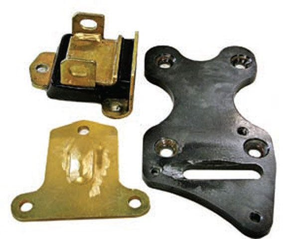 Once the center hump has been removed, the small-block Chevy mount should bolt up to the adapter. The clamshell-type mounts typically need to be ground down to the proper clearance.