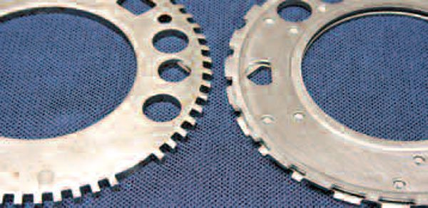 Here is the difference between a 24X (right) to 58X (left) reluctor ring, sometimes called the reluctor wheel or exciter ring. These items are reportedly easy to get out of whack, and if they're even slightly warped or otherwise out of shape, your crank sensor won't get a proper signal. Fortunately, they're replaceable, and you can buy either style ring at your GM dealer.