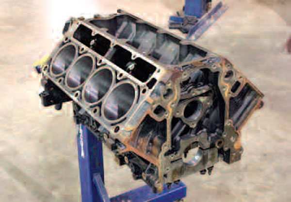 Many truck LS engines used iron engine blocks for enhanced durability without concern for weight savings, like this Gen III LQ9. Like many other LS blocks, this is a great engine block to reuse; don't let a little outside surface rust turn you off! (Also, because of their advantages in strength, those looking to build a very high-horsepower LS may be interested in swapping out an aluminum block for an iron one like this. You should be able to pick one up used or even buy one new from GM, more on all this in a moment.)