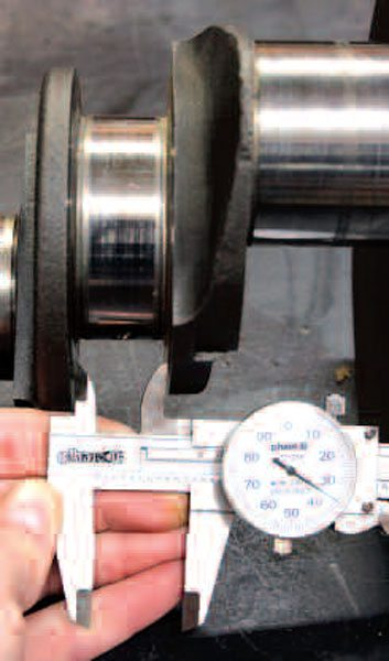 A notable wear area of the crank is the thrust surface that exists on main journal 3 (which acts to limit crank fore-to-aft movement). You should inspect this surface for excess wear and measure its width. Here you can see we're showing 1.035 inch, which is a little more than GM normally recommends; however, if the surface finish here can be polished up well, thrust bearings with thicker surfaces can be purchased to compensate for excess width.