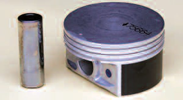 Stock and mild high-performance rebuilds should choose a piston made from a cast eutectic or hypereutectic aluminum material. The advantages of this type of piston are a lower cost and reduced thermal expansion versus a forged piston. The latter translates to reduced engine noise, reduced oil consumption, and longer component life. This is a 0.010-inch oversize LS1 piston available from GM Performance Parts. Note the flat-top design, typical of many factory Gen III/IV pistons.