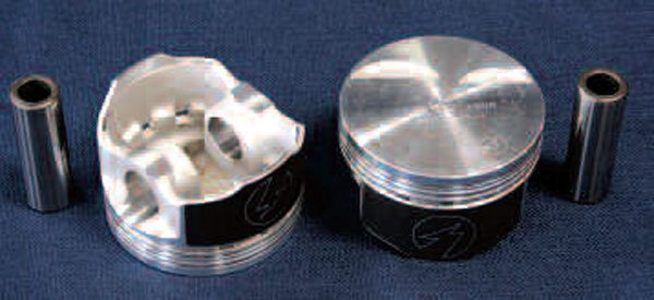 Most high-performance applications should choose a forged aluminum piston. While much stronger than a cast-type piston and better able to withstand the rigors of higher cylinder pressures and heat, forged pistons are more expensive. The extra money is well worth it for a high-powered engine, especially when used with forced induction or nitrous oxide. This is a Speed-Pro POWERFORGED piston. As with many aftermarket pistons, this one has valve reliefs, which in this case are designed with high-lift performance cams in mind in order to increase piston-to-valve clearance (some factory pistons have them too).