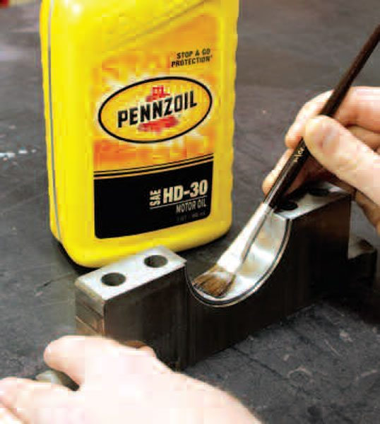 Quality non-synthetic engine oil will aid in lubricating bearings and other surfaces during pre-assembly. Heavier-weight oils such as SAE 30 are preferred as they stick to surfaces better than lightweight oils like 5W-30. Also, if you have special assembly lubricants for bearings, now is probably not the time to use them, unless you'll have a sufficient amount left over for final assembly.