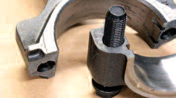 "Regardless of whether you are able to separate your rod from your piston at home, you can still have a look at some critical aspects of them. One such area is the fractured (or ""cracked"") cap mating surface of steel LS rods, as seen here. The nature of this surface dictates that each cap is an exact match to its rod (if for some reason you lack the correct caps, your rods are garbage). Though this area is designed to look ""broken,"" any evident imperfections—for example, from parts droppage—on either the cap or beam end of the rod mean that the rod can't be reused."