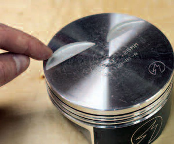 """It's best to select a piston with properly sized valve reliefs to allow sufficient piston-to-valve clearance before making your purchase. However, some high-performance applications using large valves and/or cam profiles may require additional machine work to make valve reliefs even larger. One important item to note is that in the case of cylinder heads with large-diameter valves, your machine shop should ensure that your piston's valve reliefs are sufficient not only in depth, but in width and height. So-called radial piston-to-valve clearance should be at least 0.060-inch; this must be verified in addition to the """"regular"""" piston-to-valve clearance measurements that are checked in Chapter 7."""