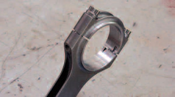 One thing you may want to keep in mind when selecting a connecting rod is that aftermarket rods with smaller-than-stock journal bore diameters are available. The advantage? It allows the overall width of the rod to be reduced and, therefore, affords more rod-to-block clearance on strokers. They of course are designed to be used with a corresponding small-journal crank. Note also that this is an H-beam rod and that it uses caps located by dowels, as opposed to the self-locating fractured design used on factory steel rods and by other aftermarket companies.