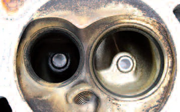 As far as head checks, have a look at the castings for any visible cracks (for example, between the valve seats). Items like warpage of the casting, as well as condition of the valve seats and guides, will need the expert eye of a machinist for full evaluation. If your heads are deemed unusable, don't worry: used ones are readily available.