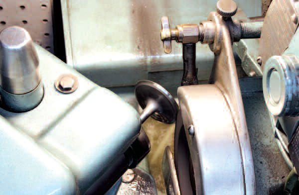 Here, a valve is refaced on a special grinding machine. Since this process spins the valve at high speed, it will also reveal any issues with valve stems that are not straight. This is not uncommon on LS engines: from this set of 16 used LS1 valves, 5 intake and 3 exhaust valves were bent! Fortunately, replacement valves are readily available from the likes of GMPP, Federal-Mogul, and other suppliers. It should also be noted that some valves are not capable of being refaced at all, so don't be surprised if your machine shop has to acquire new ones for you.