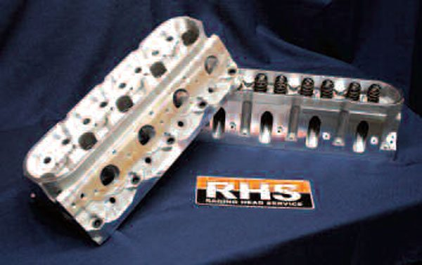 Some of the best-quality aftermarket cylinder heads available are those made by Racing Head Service (a division of COMP). Available both unassembled and ready-to-go, these particular heads are RHS's ProElite units, here equipped with high-flow 225cc intake ports. These Gen III-style heads feature a revised 11-degree valve angle, CNC machining, and other trick features for increased flow over similar factory-based castings (newer-style, rectangular-port heads are also now available from RHS). Their 0.800-inch-thick deck surfaces also make them ideal candidates for engines that will create the huge cylinder pressures typical of nitrous or forced induction.