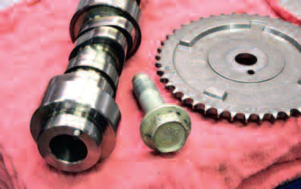 "Whereas earlier LS engines used three small bolts to hold the cam sprocket in place, later on, GM started using a ""single-bolt"" camshaft and sprocket design. As you can see from this photo, because the newer cams require use of a large centrally-located bolt, you will need to make sure your cam and timing set are compatible with one another (this goes for both factory and aftermarket equipment). These types of cams and sprockets started showing up around the same time that VVT debuted on other LS engines, where a so-called actuator solenoid valve replaces the central bolt."